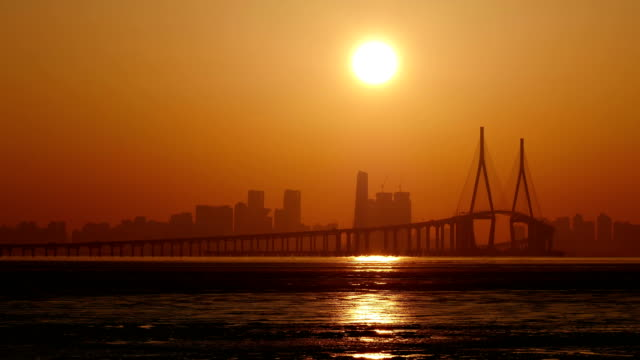 sunrise view of incheon bridge and songdo from mud flat - mud flat stock videos & royalty-free footage