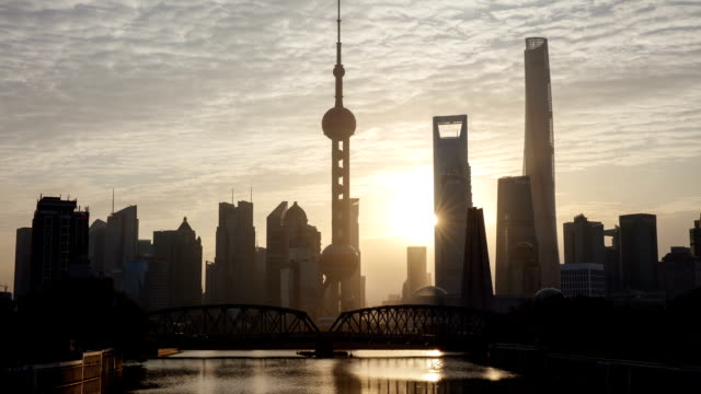 Sunrise view of Oriental Pearl Tower and SWFC with skyscrapers at dawn in Shanghai, China