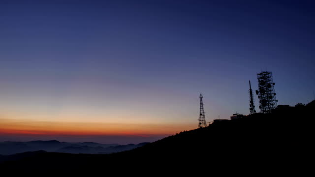 sunrise view of the repeater tower at mountain peak of hambaeksan - peak tower stock videos and b-roll footage