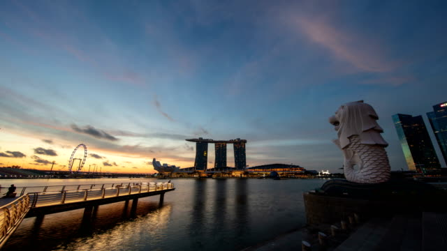 sunrise view over merlion park and marina bay sands hotel, singapore - time stock videos & royalty-free footage