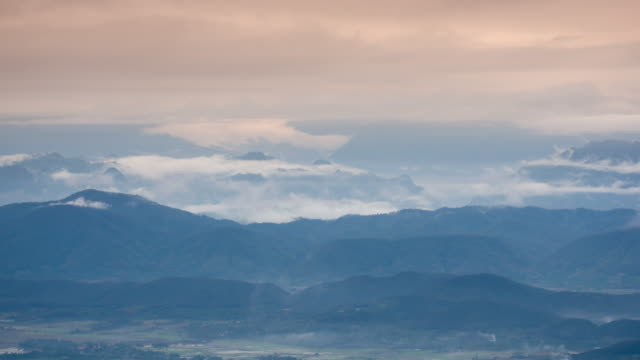 Sunrise with fog and Moving mist on the mountain , time-lapse