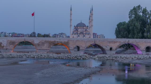 sunrising timelapse of stone bridge (taskopru) and sabanci central mosque in adana, turkey - mesopotamia stock videos and b-roll footage