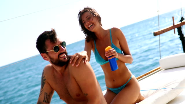 sunscreen is a must have. - swimwear stock videos & royalty-free footage