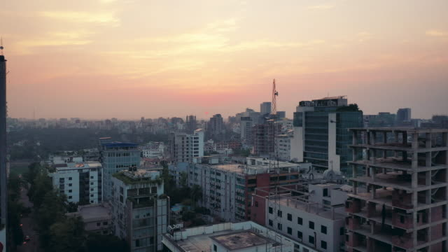 sunset 4k drone video of the cityscape of dhaka, bangladesh - dhaka stock-videos und b-roll-filmmaterial