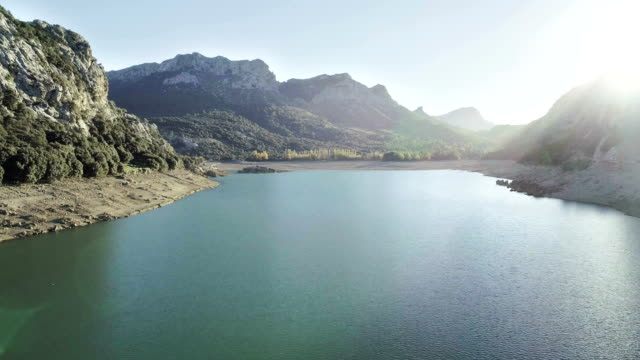 sunset above lake. mountain landscape - balearic islands stock videos and b-roll footage