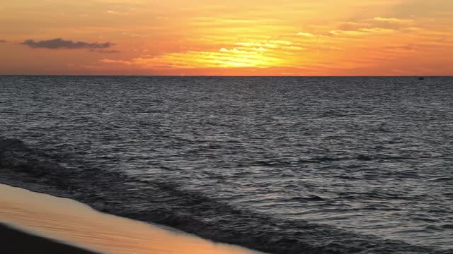 sunset across a calm sea - caribbean sea stock videos & royalty-free footage