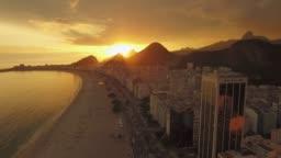 Sunset Aerial Copacabana Beach Rio de Janeiro flying past buildings along beach