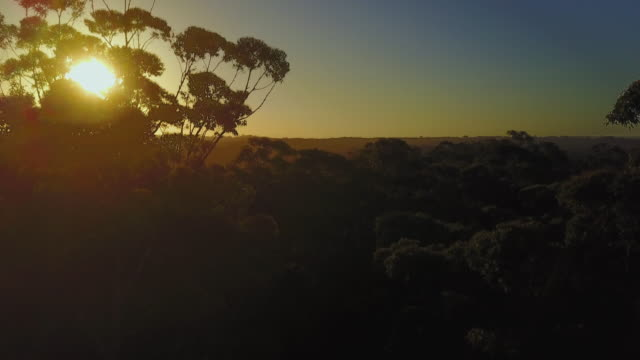 4K Sunset Aerial View Flying towards the sun, Jervis Bay, Australia.
