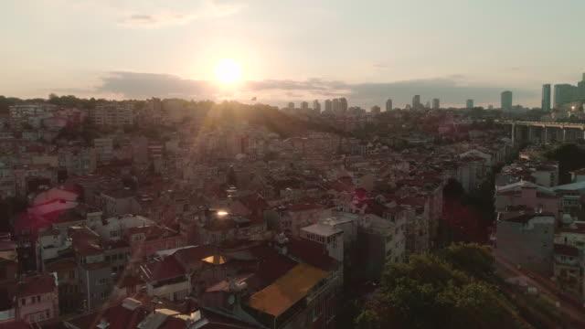 A sunset aerial view next to Bosphorus Bridge over Istanbul neighbourhood rooftops of Otrakoy. Istanbul. Turkey.