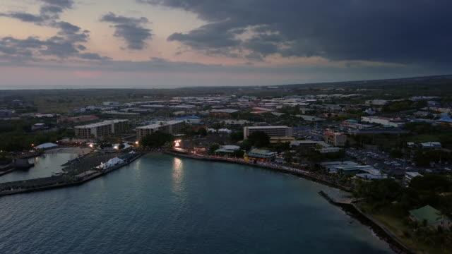 sunset aerial view of finish of ironman world championships 2018, hawaii, usa - big island hawaii islands stock videos & royalty-free footage