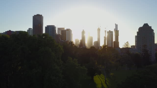 sunset aerial view of the skyline of melbourne and carlton gardens, victoria - viewpoint stock videos & royalty-free footage