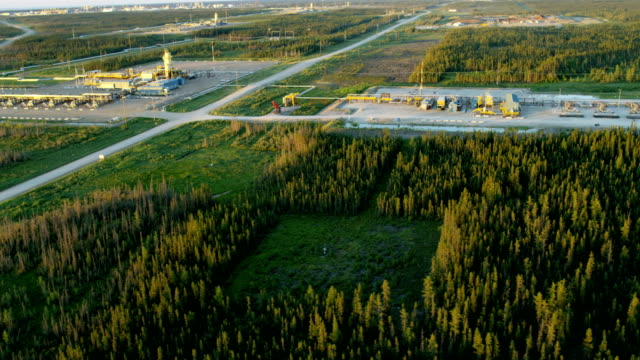 sunset aerial view oil refinery athabasca tar sands - tarmac stock videos & royalty-free footage