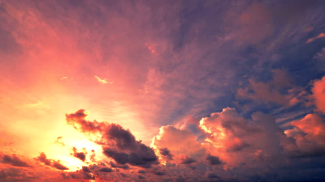 sunset and cloudscape moving - red cloud sky stock videos & royalty-free footage