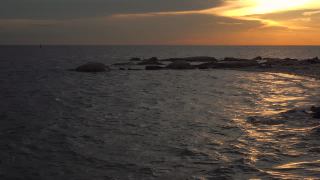 sunset and gold reflection on sea - island stock videos & royalty-free footage