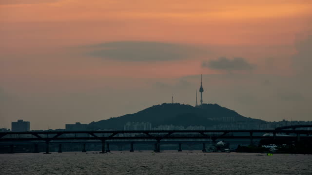 sunset and night view of han river and cheongdamdaegyo bridge in summer - river han stock videos & royalty-free footage