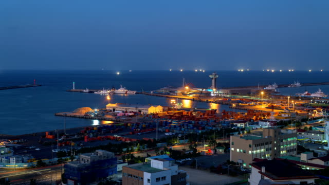 sunset and night view of jeju harbor in jeju city, jeju-do island, south korea - anchored stock videos & royalty-free footage