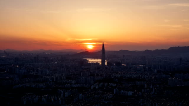 Sunset and night view of Lotte World Tower (the tallest building in Korea) and downtown Seoul