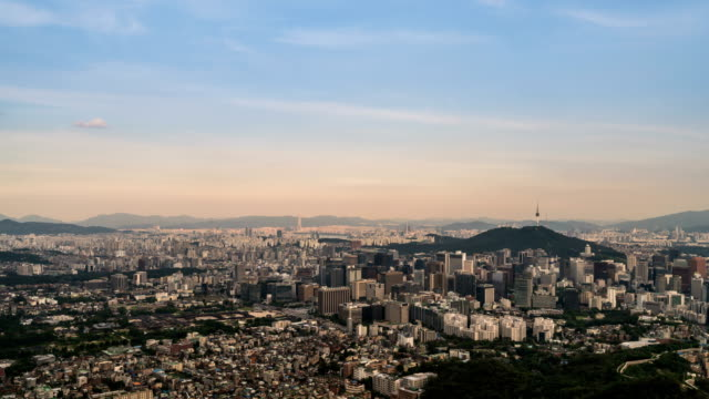 sunset and night view of the buildings in jongno district, seoul - horizont stock-videos und b-roll-filmmaterial