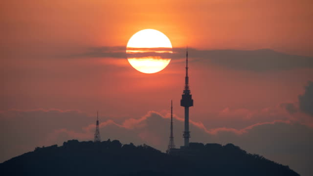 sunset and nightscape of n seoul tower in summer - south korea stock videos & royalty-free footage