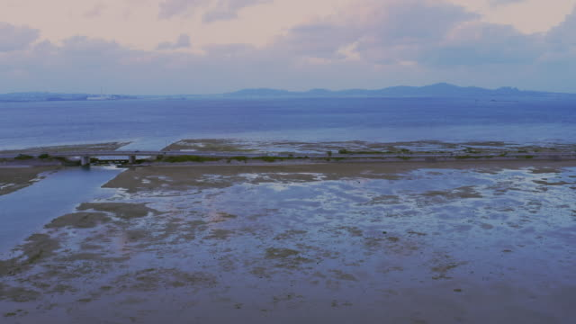 sunset and ocean road. low tide. - low tide stock videos & royalty-free footage