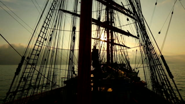 sunset and rigging of an old sailing ship - rigging stock videos & royalty-free footage