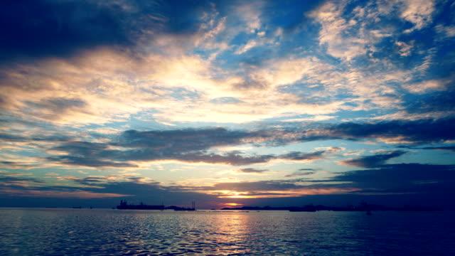 vidéos et rushes de coucher de soleil et mer, time lapse. - auréole