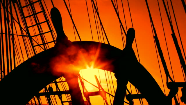 sunset and ship's steering wheel - rigging stock videos & royalty-free footage