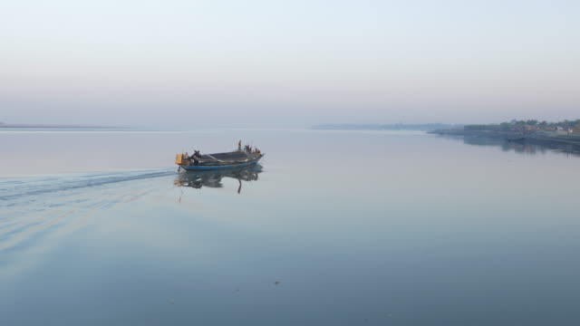 sunset and twilight are reflected in the calm glassy flat river jamuna in northern bangladesh - bangladesh stock videos and b-roll footage