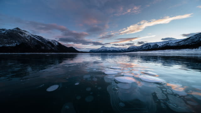 sunset at abraham lake in winter with ice bubble - alberta stock videos & royalty-free footage
