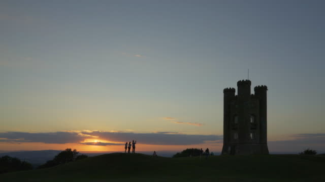 sunset at broadway tower. - cotswolds stock videos & royalty-free footage