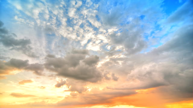 sunset at cloud time lapse 4k(hdr) - cloudscape stock videos & royalty-free footage