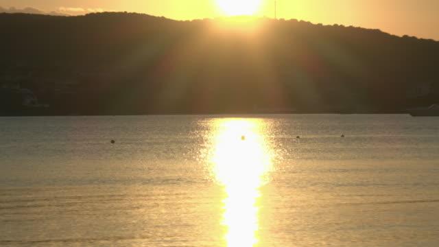 zo / sunset at coast of golfo aranci - sassari stock videos & royalty-free footage