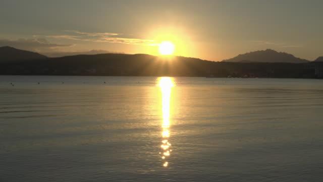 sunset at coast of golfo aranci - sassari stock videos & royalty-free footage