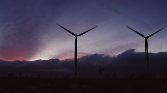 sunset at desert wind farm - grey colour stock videos & royalty-free footage
