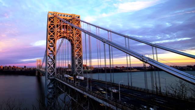 sunset at george washington bridge - hängbro bildbanksvideor och videomaterial från bakom kulisserna