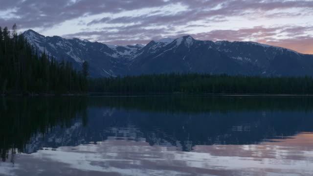 sunset at grand teton and jackson lake - grand teton stock-videos und b-roll-filmmaterial