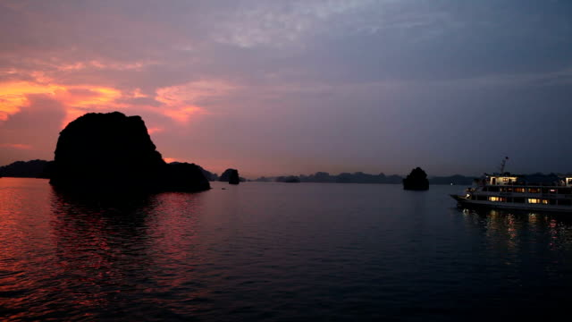 sunset at halong bay in vietnam - halong bay stock videos and b-roll footage