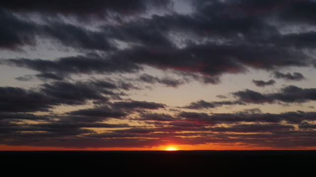sunset at horizon - horizon over land stock videos & royalty-free footage