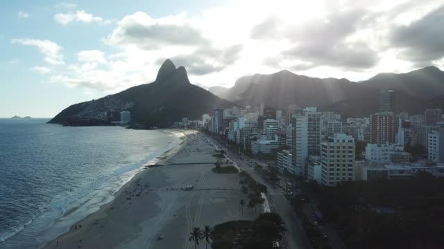 sunset at ipanema beach, in rio de janeiro, brazil - rio de janeiro stock videos & royalty-free footage