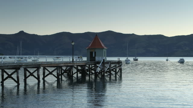 sunset at jetty - akaroa stock videos & royalty-free footage