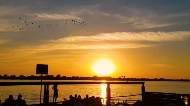 sunset at lake guaíba - alegre stock videos & royalty-free footage