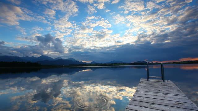 stockvideo's en b-roll-footage met sunset at lake hopfensee - bavaria -germany - steiger pier