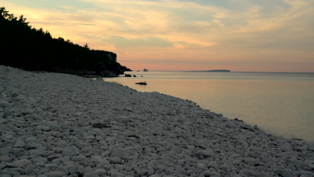 sunset at lake hurone, bruce peninsula, tobermory, ontario, canada - ontario canada stock videos and b-roll footage