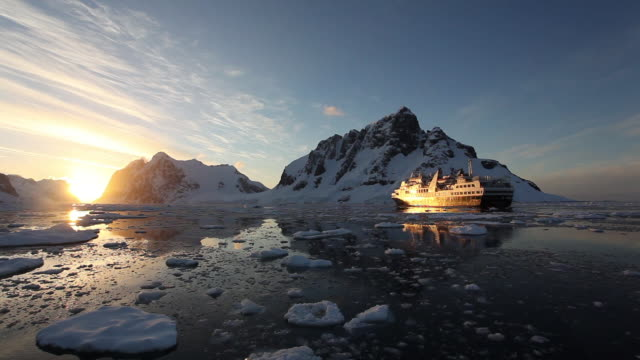 sunset at lemarie channel - antarctica sunset stock videos & royalty-free footage