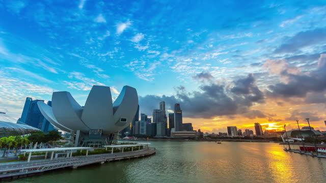 sunset at marina bay sands singapore - marina bay singapore stock videos and b-roll footage