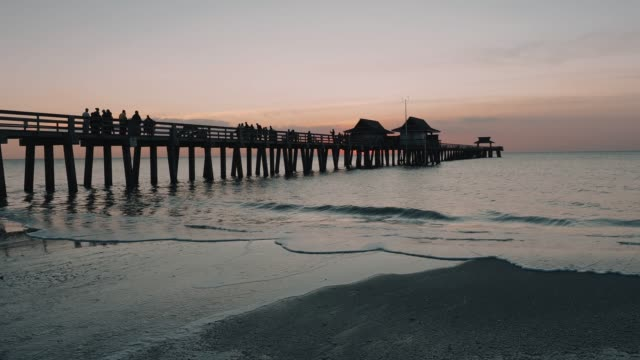 sunset at naples pier, florida - naples florida stock videos & royalty-free footage
