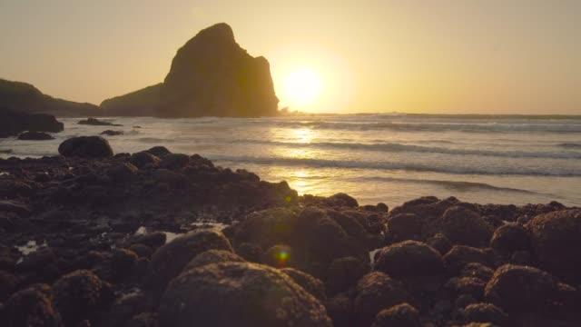 sunset at piha beach. - māori people stock videos & royalty-free footage