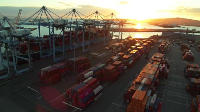 vidéos et rushes de sunset at port container terminal - aerial - groupe d'objets