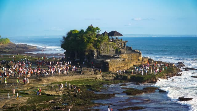 Sunset at Pura Tanah Lot Hindu Temple, Bali Indonesia