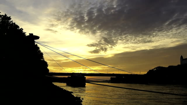 sunset at river danube,bratislava,slovakia - eastern european culture stock videos & royalty-free footage